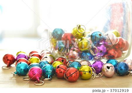 colorful bells rolling on wooden boardの写真素材 [37012919] - PIXTA
