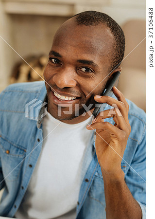 Inspired man talking on the phone 37106488