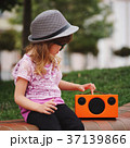 little hipster girl listens music on wireless 37139866