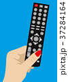 Hand holding Remote TV Control 37284164