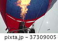 Hot air balloon. Burner directing flame into 37309005