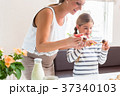 Pregnant mother baking cupcakes with her daughter 37340103