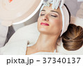 Close-up of the face of a woman relaxing during 37340137