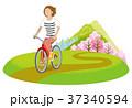 サイクリングする女性 春のあぜ道 クリップ 37340594