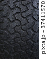 Closeup on a tire on a dark background 37411570