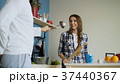 Happy couple having fun in the kitchen fencing 37440367