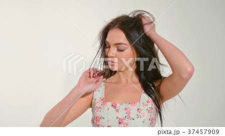 Portrait of beautiful young woman at studio on the 37457909