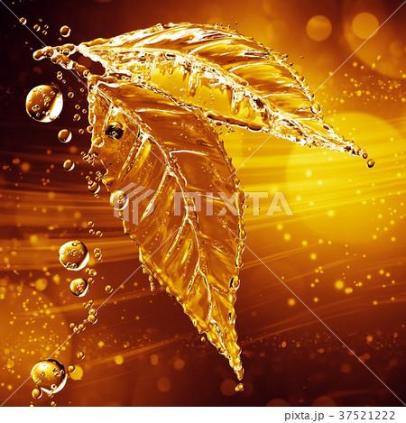 Leaf made of water splash. Gold color 37521222