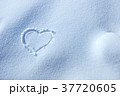 Heart symbol written in the snow 37720605