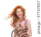 Headshot of a redhead in a colourfull dress. 37747657
