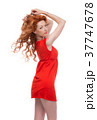 Sideshot of a redhead in a dress. 37747678