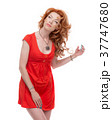 Redhead in a red dress. 37747680
