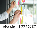 Hand writing paper note, sticky note on glass. 37779187