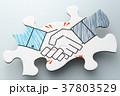 握手するイラストが描かれたジグソーパズル。グレーのグラデーションの背景。 37803529