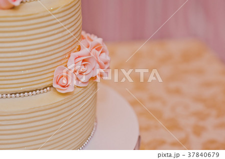 Beautiful sweet cake with rosettes 7788. 37840679