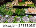 Fish, chicken and herbs on local market 37853035
