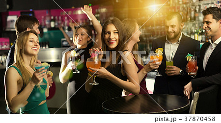 cheerful employees dancing on corporate partyの写真素材 37870458