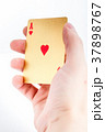 Golden ace in a hand 37898767