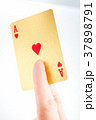 Golden ace in a hand 37898791