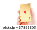 Golden ace in a hand 37898805