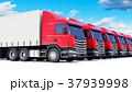 Row of cargo trucks against blue sky 37939998