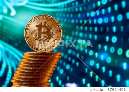 Stack of golden bitcoins with one bitcoin on its 37994401