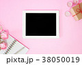 Tablet blank screen  with pink rose flower on pink 38050019