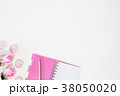 Notebook and pen with rose flower on table. 38050020
