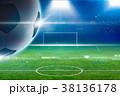 Big soccer ball, green stadium, bright spotlights 38136178