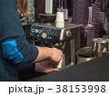 Barista prepares coffee at the coffee machine 38153998
