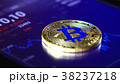 Golden bitcoins on the background of a graphic 38237218