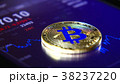 Golden bitcoins on the background of a graphic 38237220