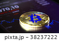 Golden bitcoins on the background of a graphic 38237222