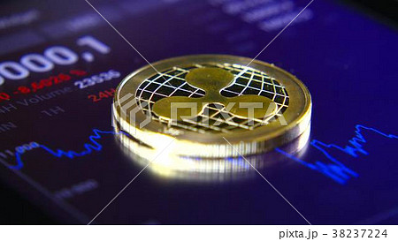 Gold coins of the ripple on the background of a 38237224