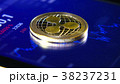 Gold coins of the ripple on the background of a 38237231