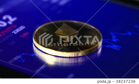 Gold coins of the ethereum on the background of a 38237236