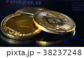Golden bitcoins on the background of a graphic 38237248