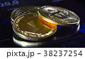 Golden bitcoins on the background of a graphic 38237254