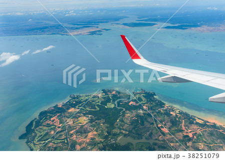 Blue sky ocean/sea and a part of airplane engine 38251079