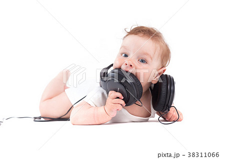 cute joyful baby boy in white shirt and headphones 38311066