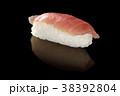 Tuna sushi on black. 38392804