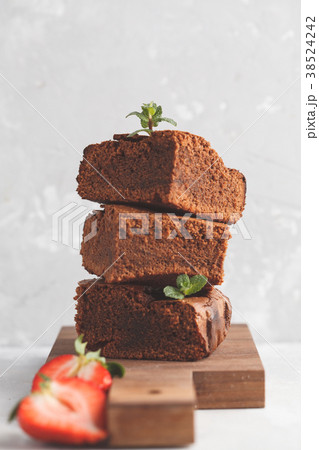 Stack of pieces of homemade dark chocolate brownie 38524242