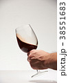 Shaking red wine glass 38551683