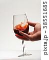 Wine glass in human hand 38551685