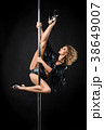 beautiful pole dancer in leather jacket on pylon 38649007