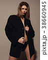 young attractive woman posing in a jacket 38660945