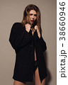 Young attractive woman posing in a man's jacket  38660946