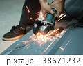 Cropped shot of Electric grinder Worker cutting. 38671232