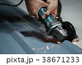 Cropped shot of Electric grinder Worker cutting. 38671233
