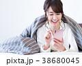 スマホ スマートフォン 女性の写真 38680045